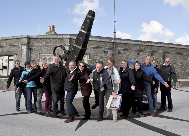 'Good Mood' members having fun on Caernarfon's compass on the promenade. The anchor is an original from HMS Conwy.